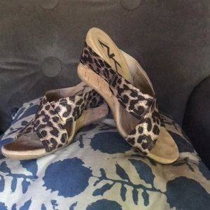 Metallic animal print wedge sandals.